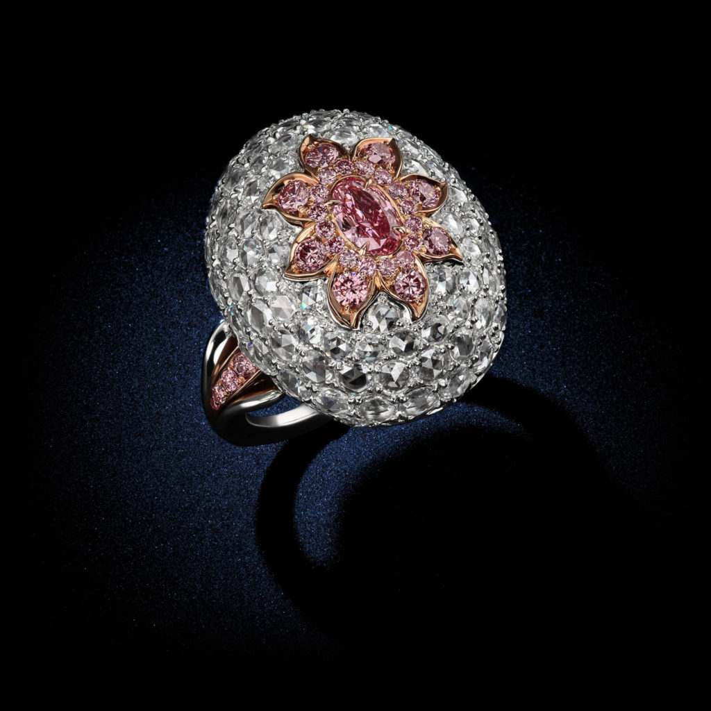 A fabulous oval shape diamond ring with a total carat weight of .37cts of Fancy Purple and Pink Argyle Diamonds GIA Certified by David Rosenberg of Rosenberg Diamonds & Co. side view
