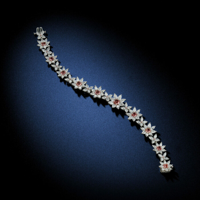 Extreme Rarity of Argyle Fancy Deep Pink makes up this beautiful flower diamond bracelet GIA Certified with an approximately 15.71 Carat Total Weight by David Rosenberg of Rosenberg Diamonds & Co.