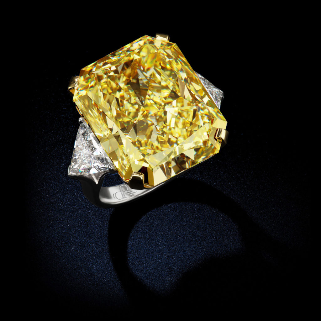 An incredible womens diamond ring featuring 37cts of Internally Flawless Fancy Intense Yellow Canary Radiant Shape Diamond Ring GIA Certified by David Rosenberg of Rosenberg Diamonds & Co. side view