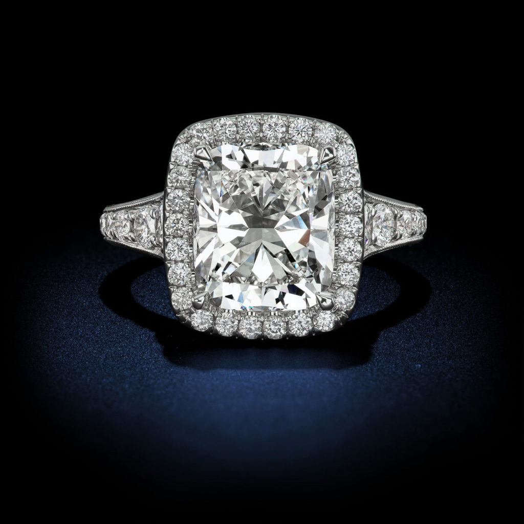 This spectacular halo design 4.20 Carats Cushion shape diamond ring with a color and clarity of G Internally Flawless 3-stone engagement diamond ring GIA Certified by David Rosenberg of Rosenberg Diamonds & Co.
