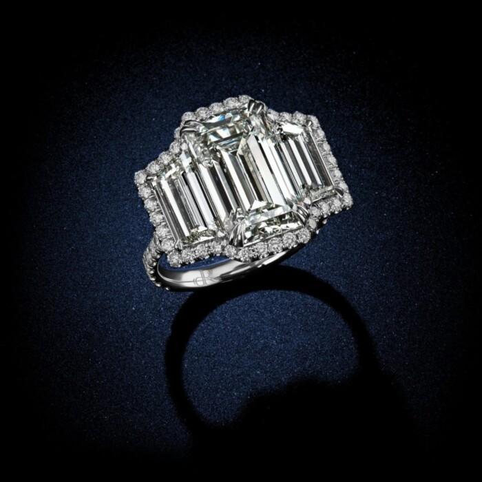 large-emerald-cut-triple-diamond-ring