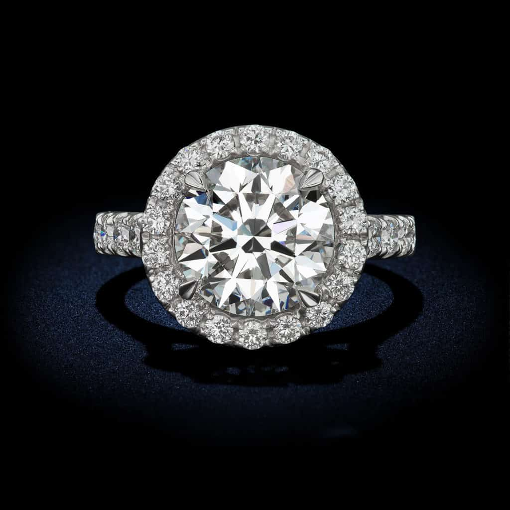 Classic-round-brilliant-diamond-engagement-ring-with-halo-setting