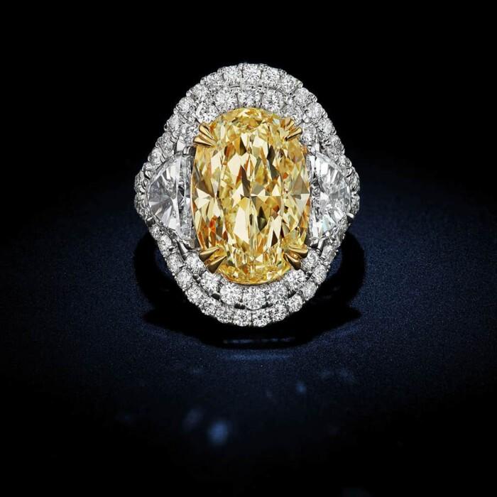 large-fancy-intense-yellow-oval-shape-diamond-ring
